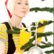 Foto Stock: Womin yellow gloves with fir