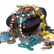 Royalty-Free Stock Photo: A lot of beads and bracelets in the hat