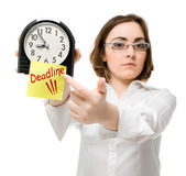 Girl points to clock (focus on clock) — Stock Photo