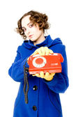 Girl with old red telephone (focus on the telephone) — Stock Photo