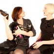 Two women fighting for shoes — Stock Photo #8324842