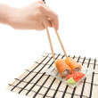 Royalty-Free Stock Photo: Woman\'s hand with chopsticks and maki sushi