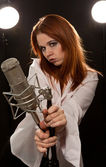 Young rock and roll singer with microphone — Stok fotoğraf