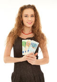 Woman with banknotes smiling — Stock Photo