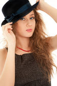Woman with hat looking to the camera — Stock Photo