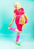 Pin-up woman in pink dress — Stock Photo