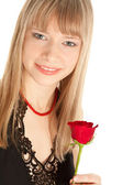 Beautiful woman with red rose isolated on white — Stock Photo
