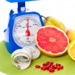 A lot of different fruits and scale — Stock Photo #8345687