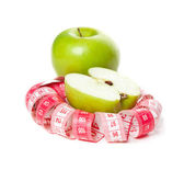 Picture of green apple and measure tape — Stock Photo