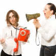 Woman with megaphone screaming to secretary — Stock Photo