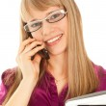 Businesswoman holding a black folder — Stock Photo