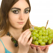 Woman with a plate  of green grapes — Stock Photo