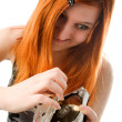 Red haired girl with hard drive — Stock Photo