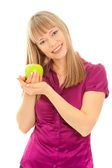 Woman with green apple smiling — Stock Photo