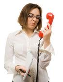 Secretary wincing to headset — Stock Photo