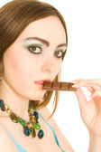 Woman with a piece of choc in her lips — Stock Photo