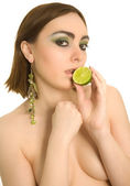 Beautiful sexy woman with lime in her hand — Stock Photo
