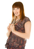 Red haired woman with beads in her mouth — Stock Photo