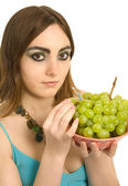 Woman with a plate of green grapes — Stock fotografie