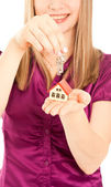 Woman's hands holding house and keys — Stock Photo
