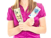 Woman's hands holding two different banknotes — Stock Photo