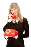 与旧电话微笑的女人 — 图库照片
