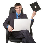 Young man with floppy disk — Stock Photo
