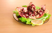 Pomegranate on a plate — Stock Photo