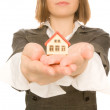 Girl holding toy house in her hand — Stock Photo