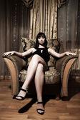 Sexy žena, sedící — Stock fotografie