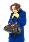 Happy curly-haired woman in coat — Stock Photo
