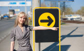 Woman showing a direction — Stock Photo
