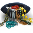 A lot of beads and bracelet in the hat — Stock Photo