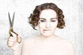 Young woman with scissors — Stock Photo
