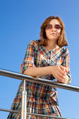 Woman in checkered dress — Stock Photo