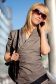 Beautiful woman with cellphone — Stockfoto