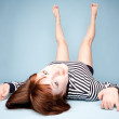 Smiling girl lying upside down - Lizenzfreies Foto