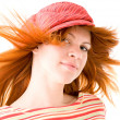 Redhead girl in striped hat — Stock Photo