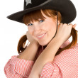 Red haired girl in cowboy hat — Stock Photo
