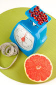 A picture of a grapefruit, pills and scale — Stock Photo