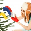 Stock Photo: Womdressing christmas tree
