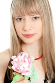 Portrait of beautiful young woman holding a flower — Stock Photo