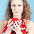 Stock Photo: Girl holding an apple