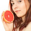 Woman with a piece of grapefruit — Stock Photo