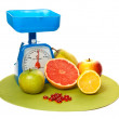A lot of different fruits and scale — Stock Photo #8780139