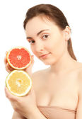Beautiful woman with grapefruit — Stock Photo
