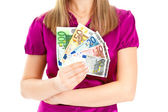 Woman holding euro in her hands — Stock Photo