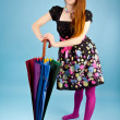 Funny girl with colorful umbrella — Stock Photo