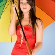 Woman with colorful umbrella — Stock fotografie