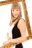 Beautiful woman standing with frame and smiling — Foto de Stock